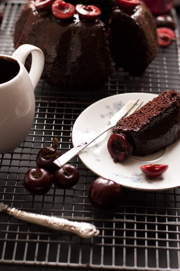 Cherry Chocolate Bundt Cake Recipe. Deep and rich in flavor, easy to make and ready in 50 mins. Incredibly tasty cake for any occasion that everyone will love! No dairy and vegan too! Yum! https://annabanana.co/