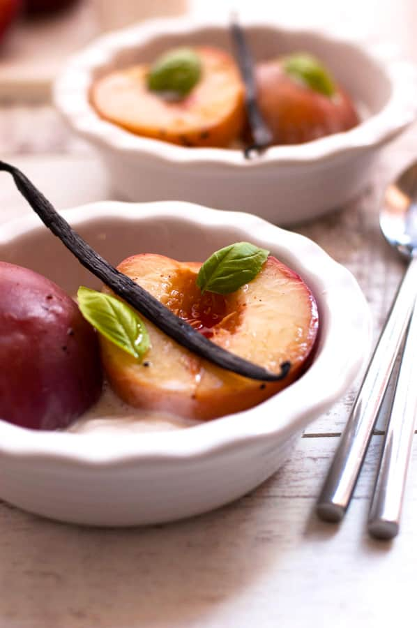 Absolutely delicious recipe for poached peaches in sparkling wine with vanilla and basil, served with whipped coconut cream. 100% vegan, gluten free and super easy to make! | https://annabanana.co/