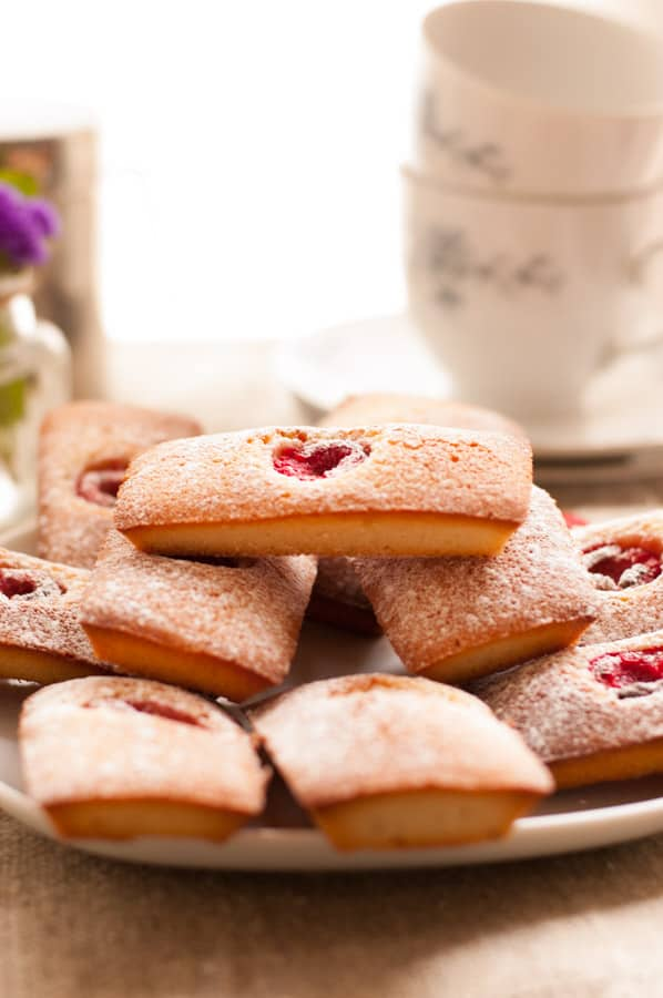 Raspberry Rose Financiers. Super light, soft and delicious cakes topped with juicy raspberries soaked in rose wine. So delicious!   http://annabanana.co/
