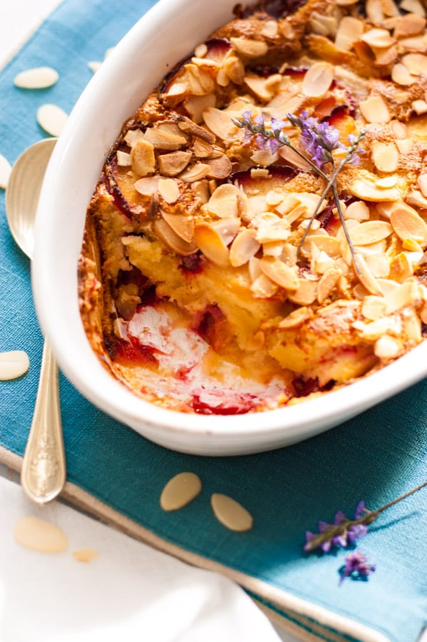 This vegan plum clafoutis is a perfect pud, studded with sharp fruit, delicately creamy centre, and a drop of brandy. Delicious and easy way to enjoy any seasonal fruit! | via@ ananabanana.co