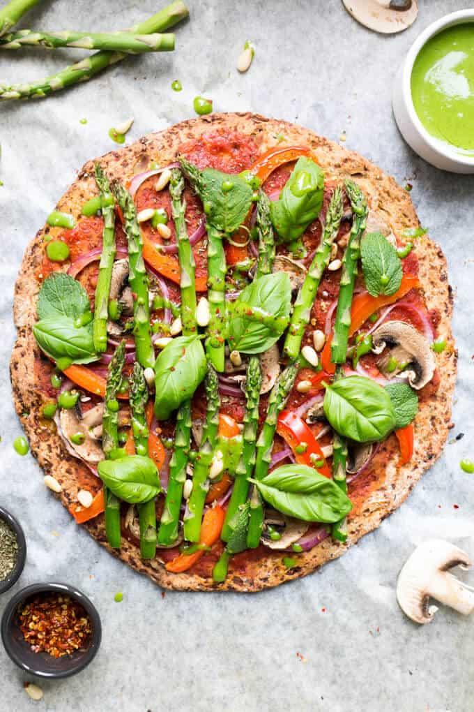 Cauliflower Pizza Crust topped with asparagus   via @annabanana.co