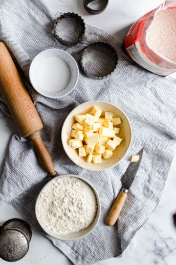 overhead shot of bowls with butter, sugar and flour