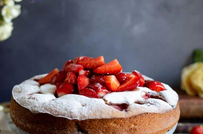 Light and moist fresh strawberry cake with icing sugar