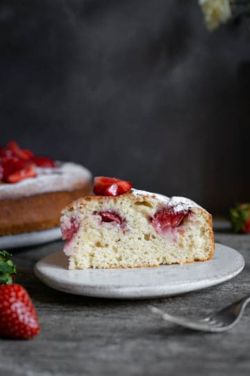 Slice of fresh strawberry cake on the plate