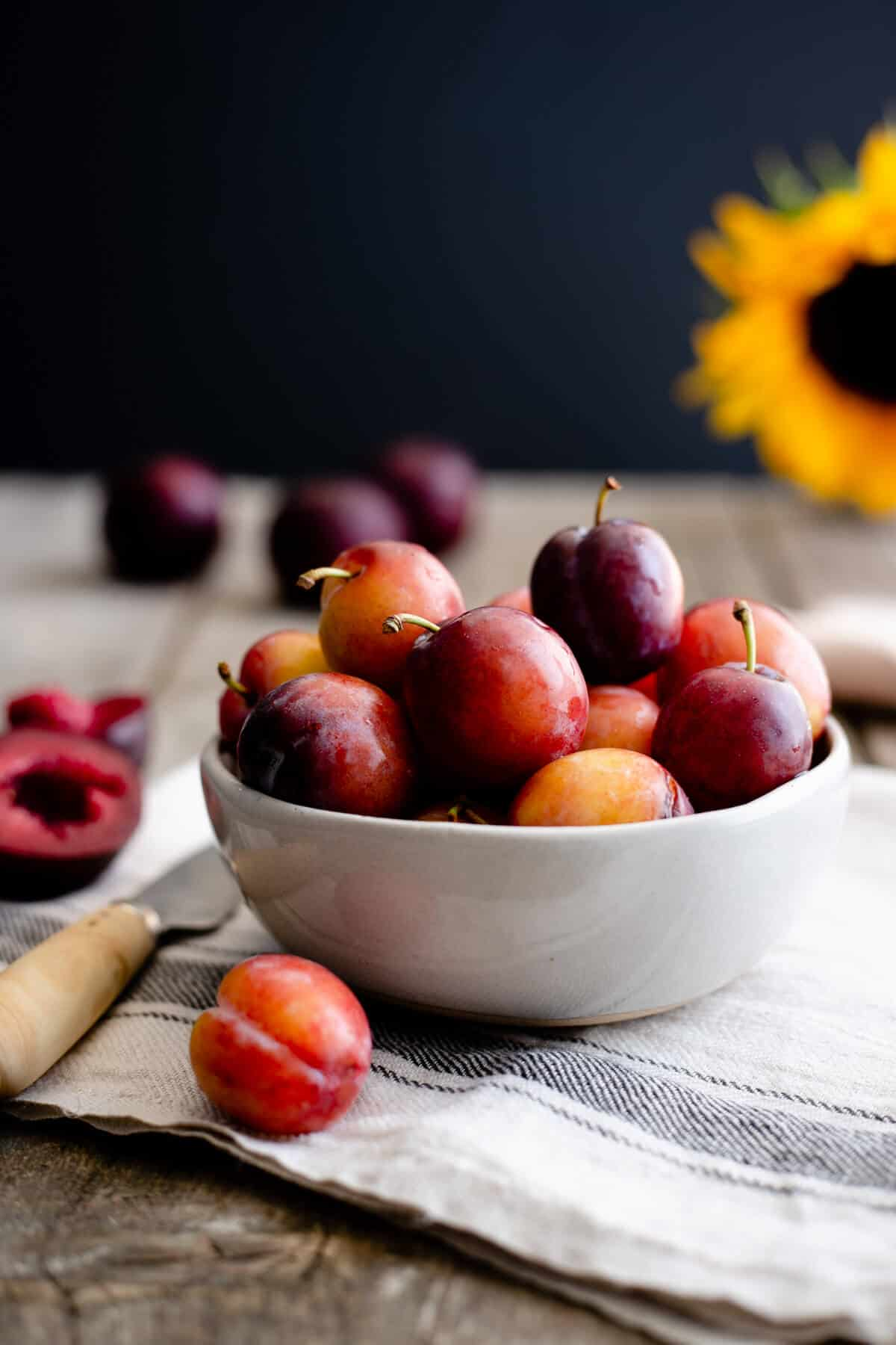 Small bowl of fresh plums
