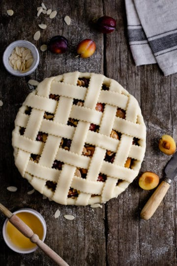 Unbaked plum lattice pie, overhead shot