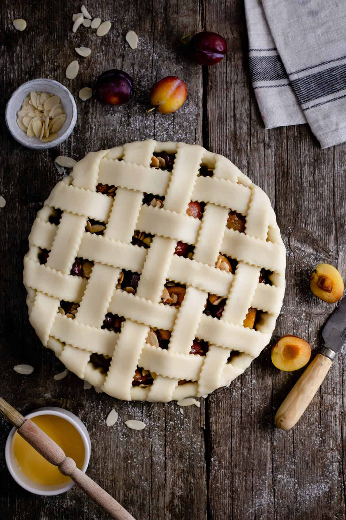 Unbaked plum lattice pie, overhead shot