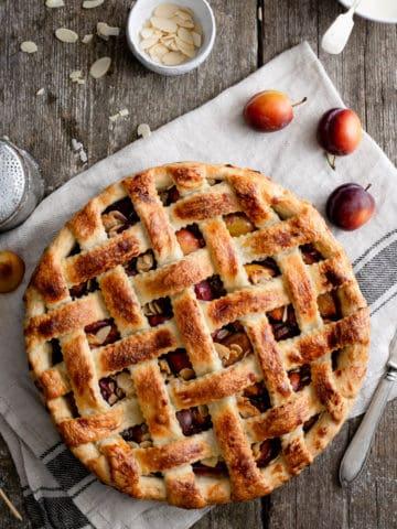 Plum and almond pie with decorative lattice pattern