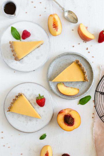 Three slices of vegan peach tart on the plates, overhead shot