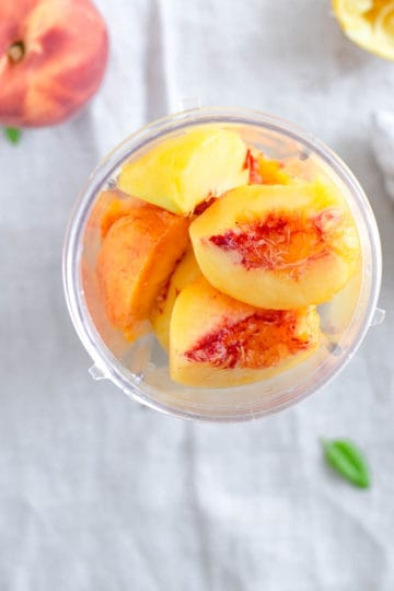 Fresh peach slices in the blender
