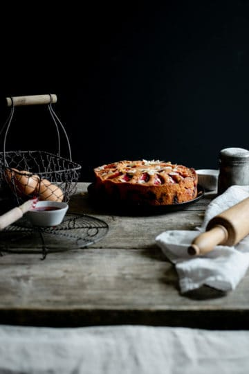 Plum and almond cake in a dark and moody set up