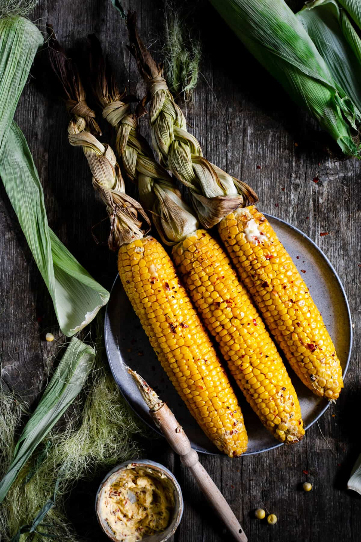 Overhead shot of oven-roasted corn on the cob with chilli butter