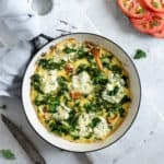 Mushroom and kale frittata with tomato and basil salad