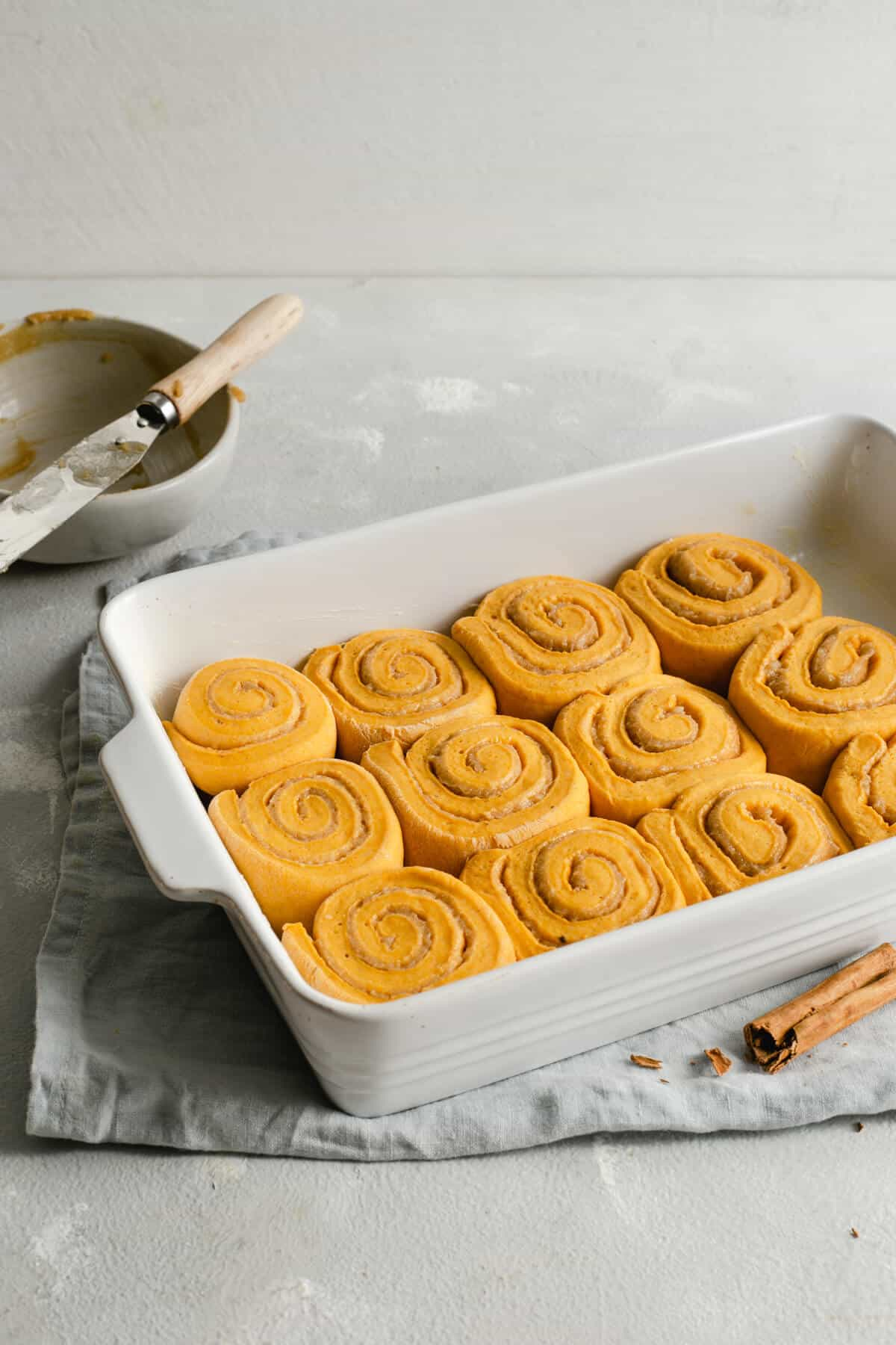 Pumpkin cinnamon rolls in a baking dish