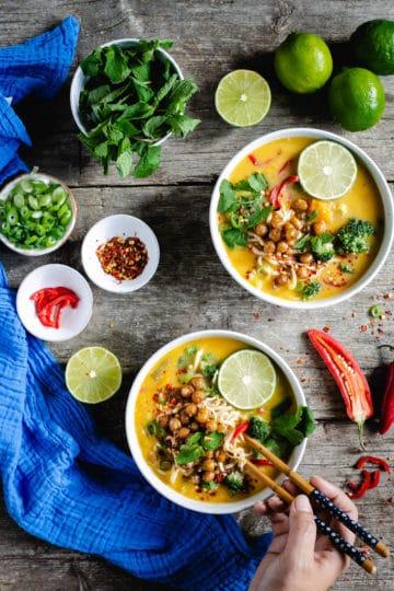 Overhead shot of two bowls of Thai style pumpkin laksa