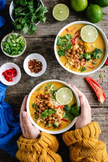 Overhead shot of two bowls of Thai style pumpkin laksa