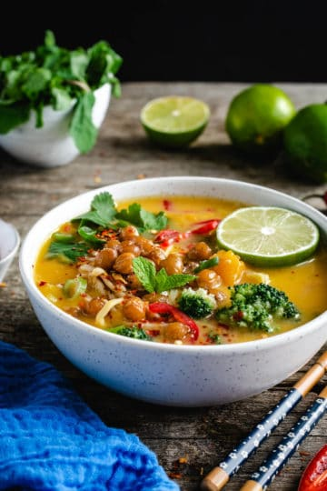 Single bowl of Thai style pumpkin laksa topped with crunchy chickpeas