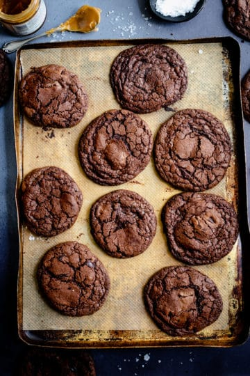 Overhead shot of chocolate cookies on the old baking tray