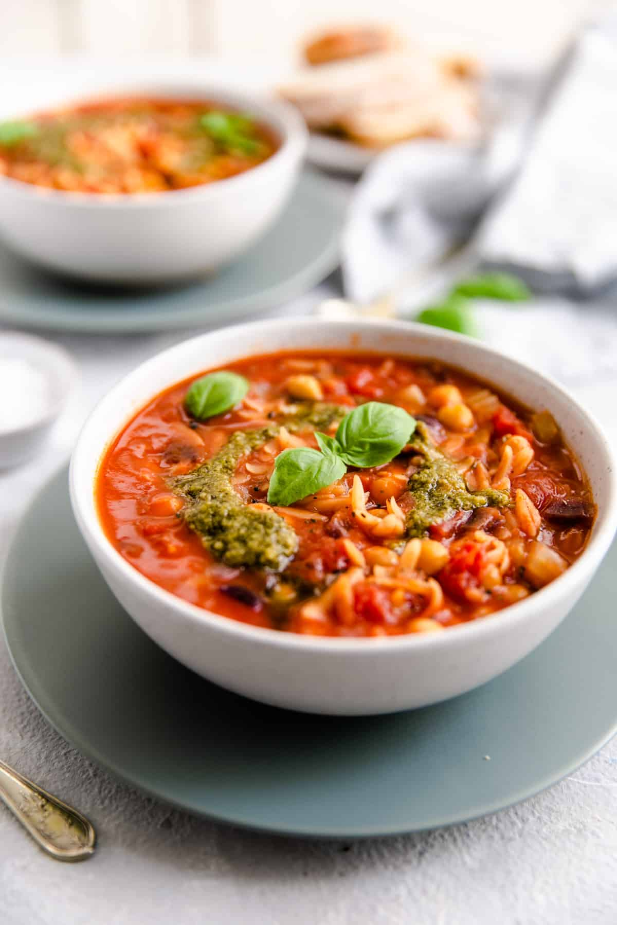 a side shot of orzo and tomato soup