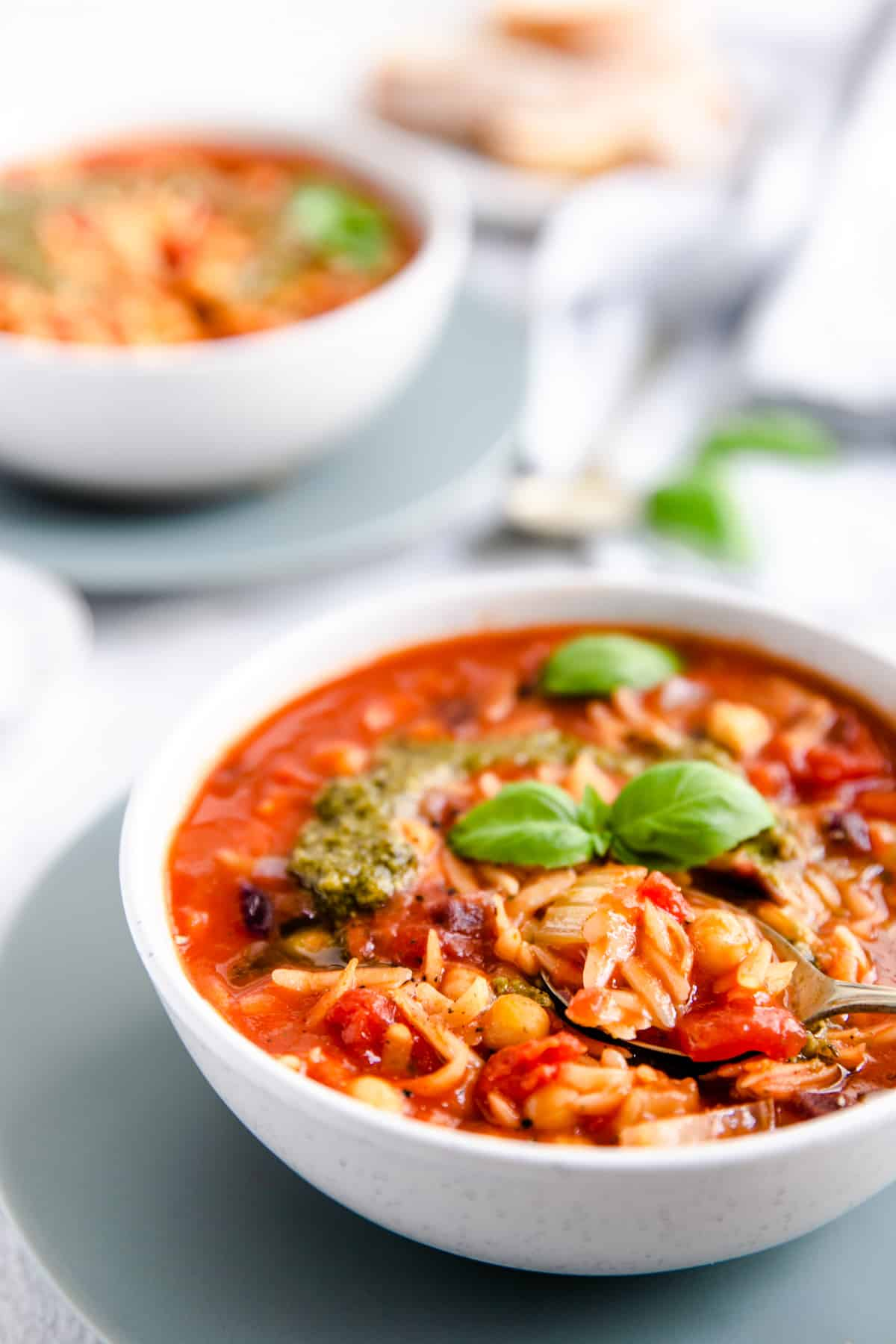 close-up side shot of orzo and tomato soup