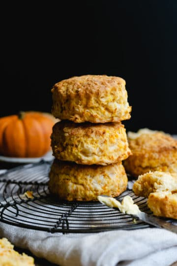 straight ahead angle of three pumpkin scones stacked on top of each other