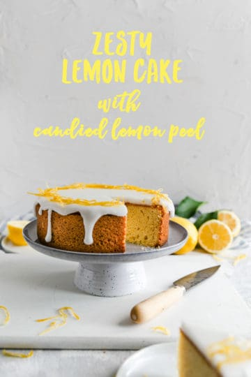 zesty lemon cake on a cake stand with a slice cut out