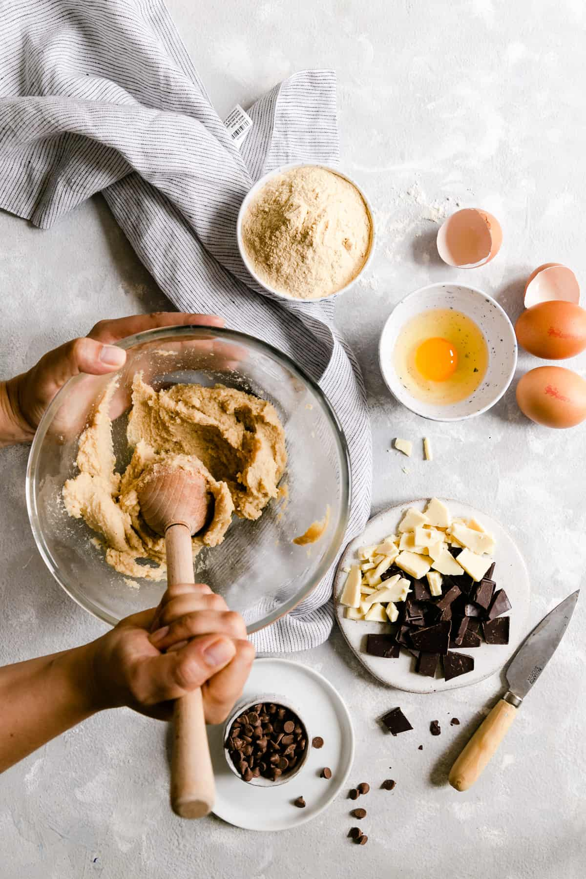 Overhead shot of a person beating butter and sugar in a large bowl