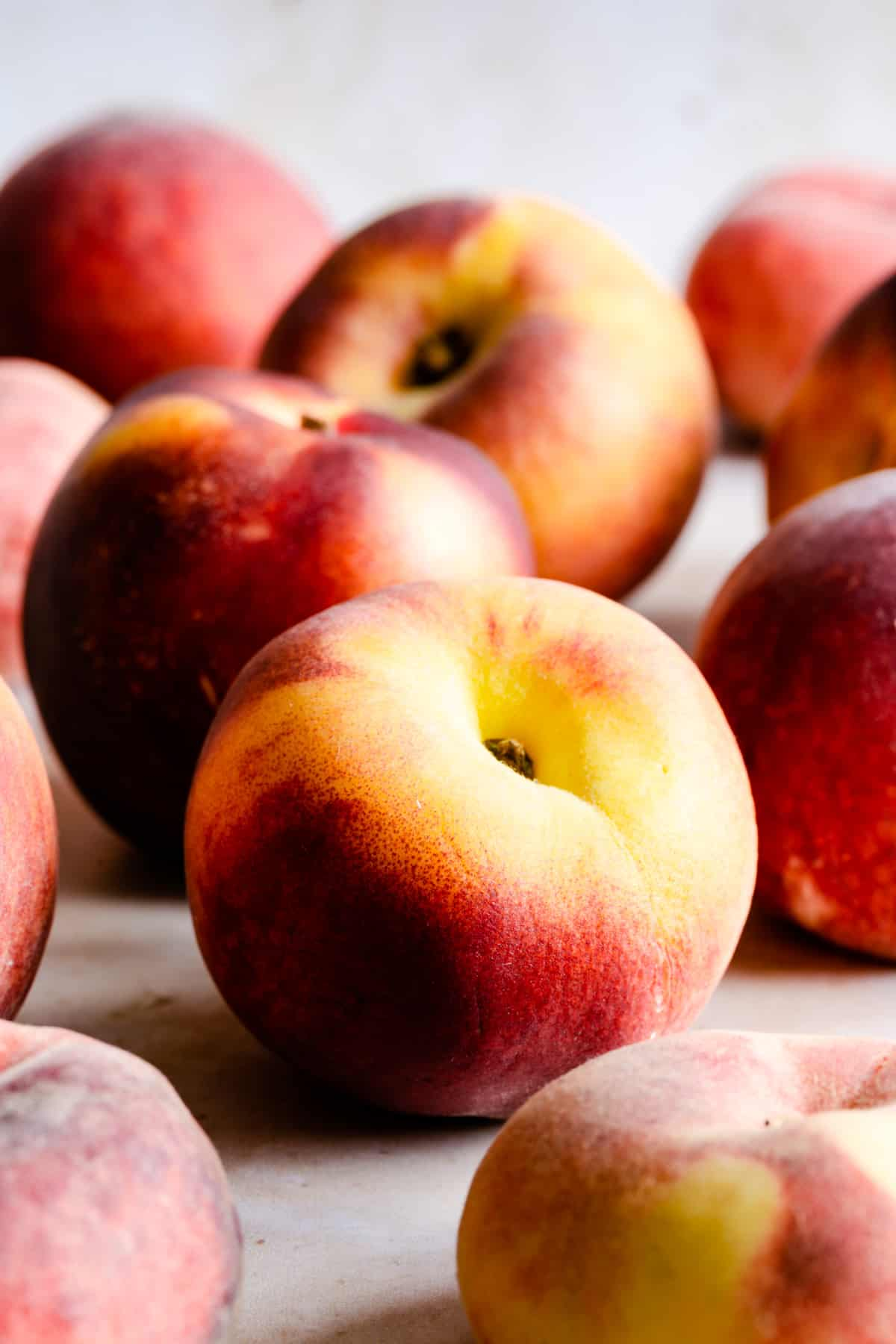 a side view of whole fresh peaches