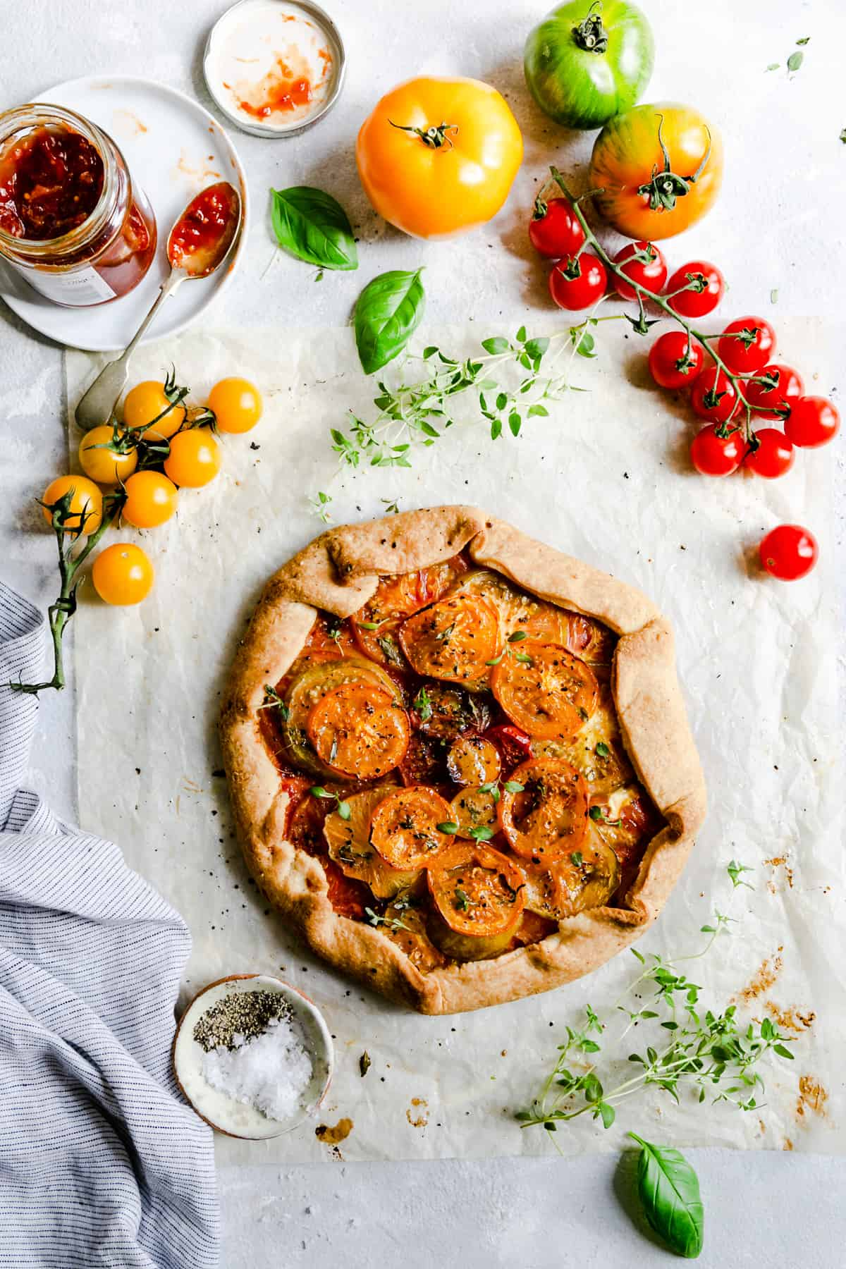 top view of the summer tomato galette topped with frsh thyme