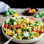 a side angle view of a bowl with grilled corn salad
