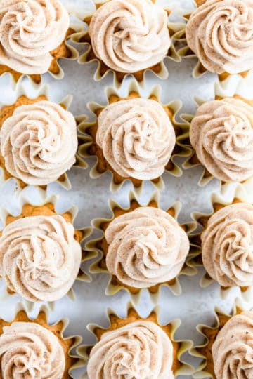 overhead close up of pumpkin cupcakes with chai frosting