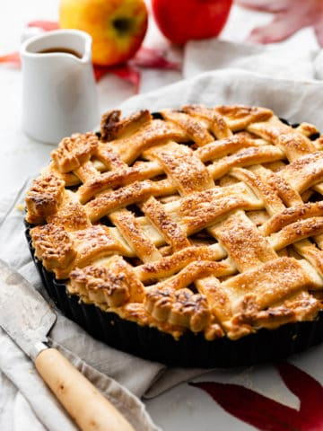 side close up of a baked apple pie with lattice top