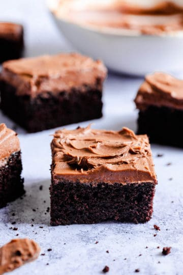 side view of chocolate cake slices topped with chocolate frosting