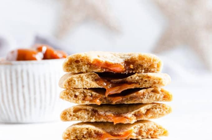 close up of dulce de leche stuffed cookies showing the filling inside