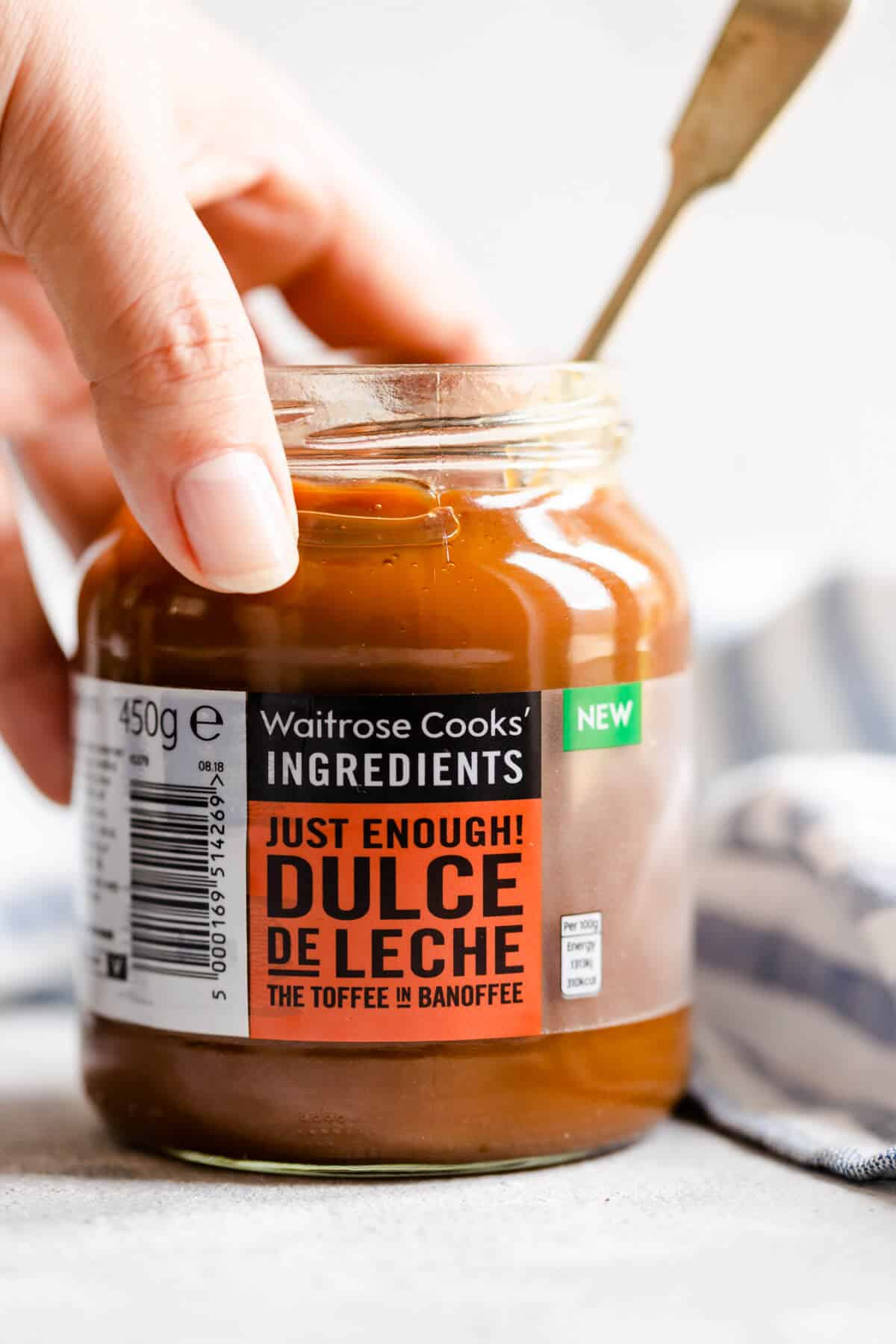 a close up of a jar of dulce de leche