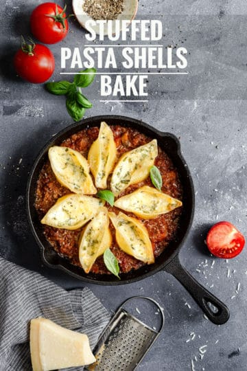 skillet with stuffed pasta shells in bolognese sauce