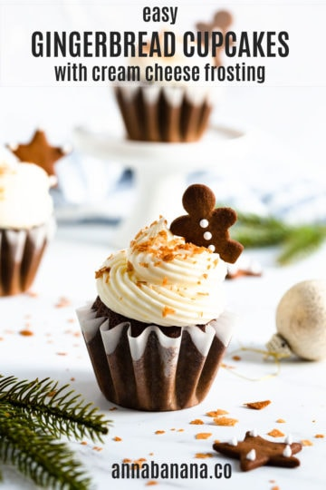 a side shot of three gingerbread cupcakes on white surface