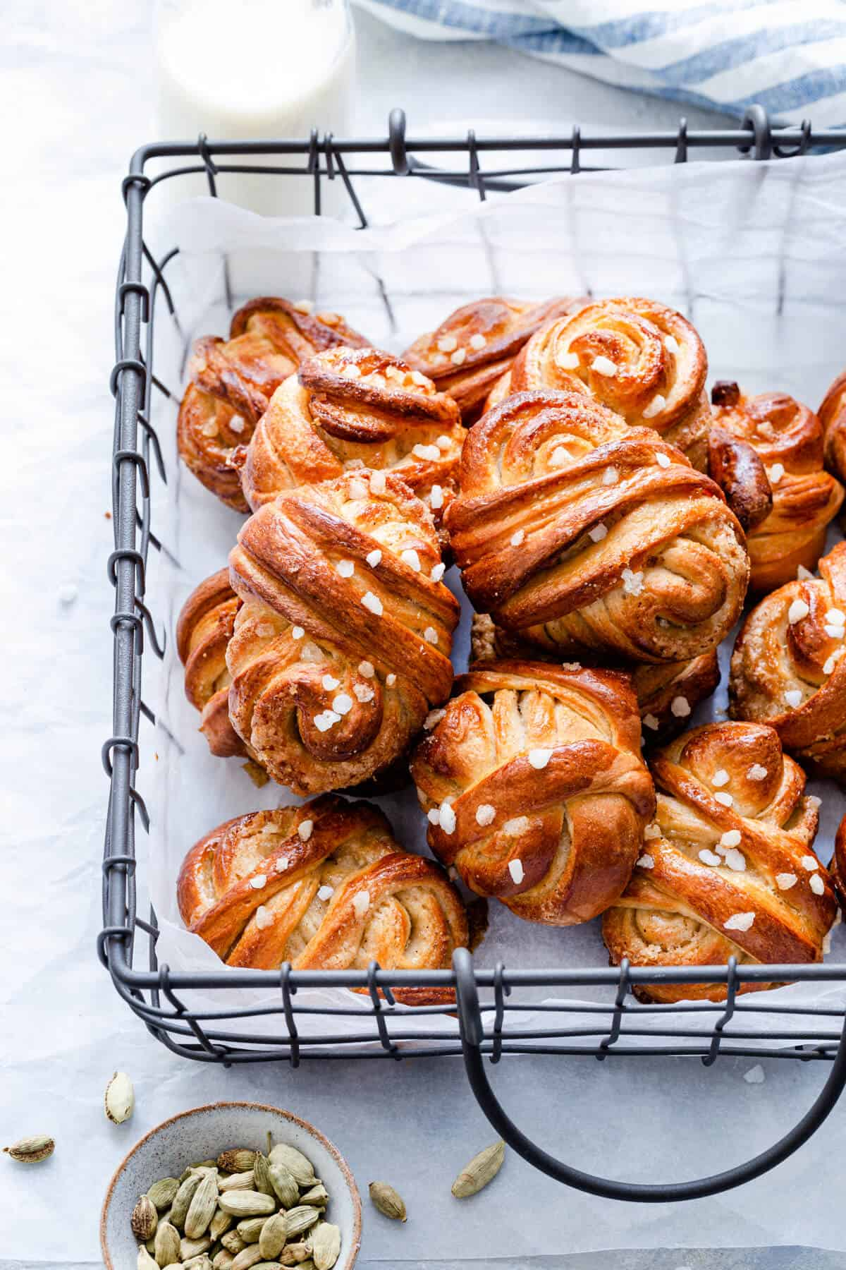 side close up of cardamom buns in a wired basket