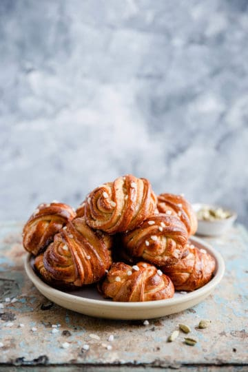 side shot of a plate with cardamom buns