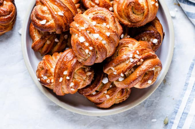 overhead shot of a plate with golden cardamom buns