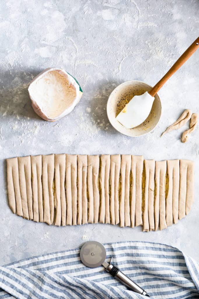 top view of a dough sliced into strips