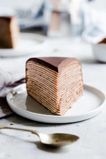 straight ahead close up of a slice of chocolate crepe cake