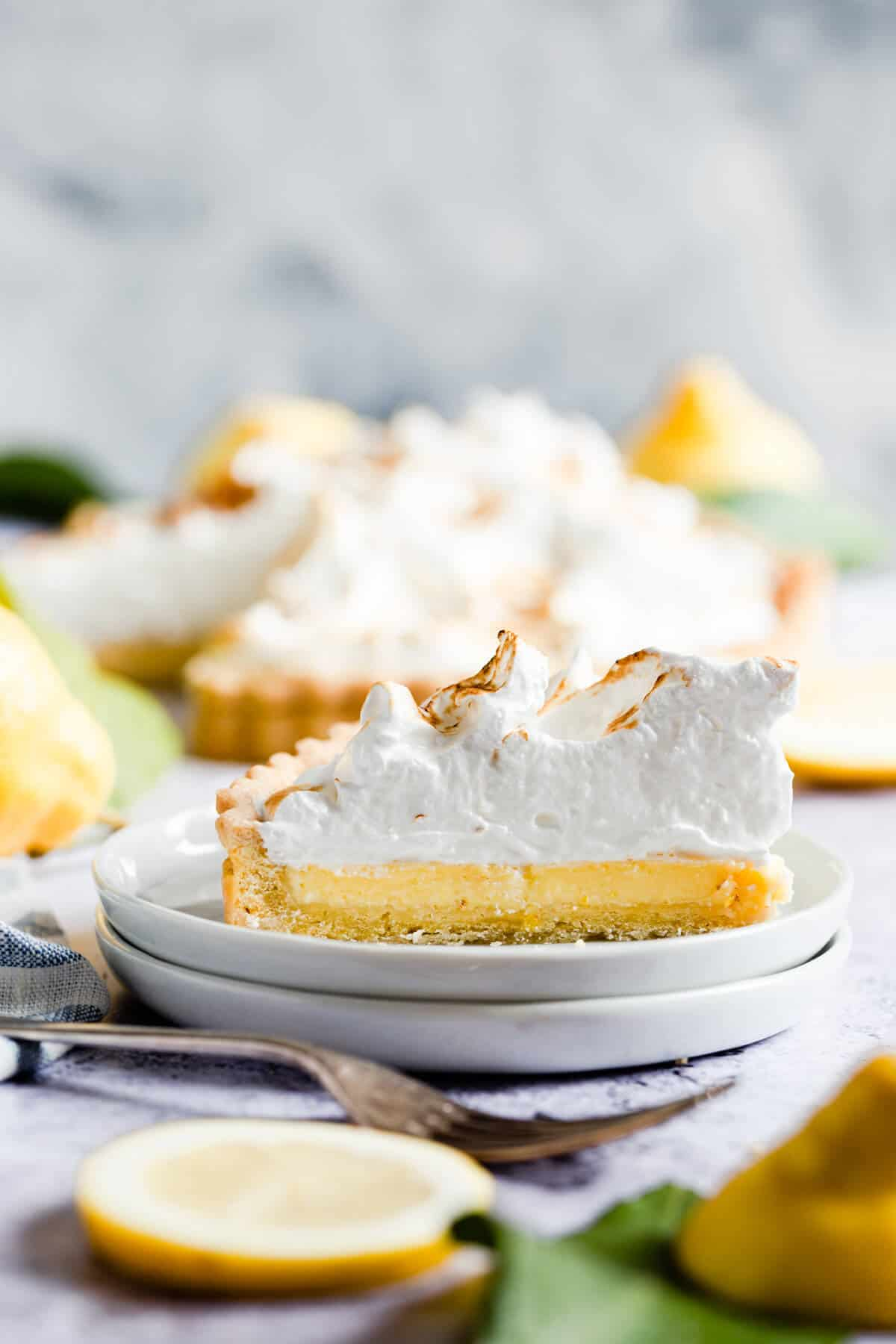 side close up of individual slice of lemon meringue pie