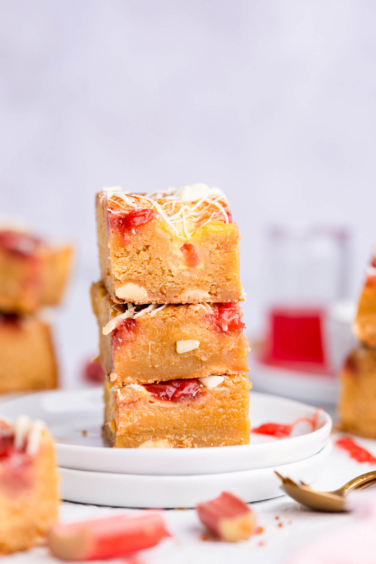 side close up shot of three rhubarb blondies stacked on top of each other