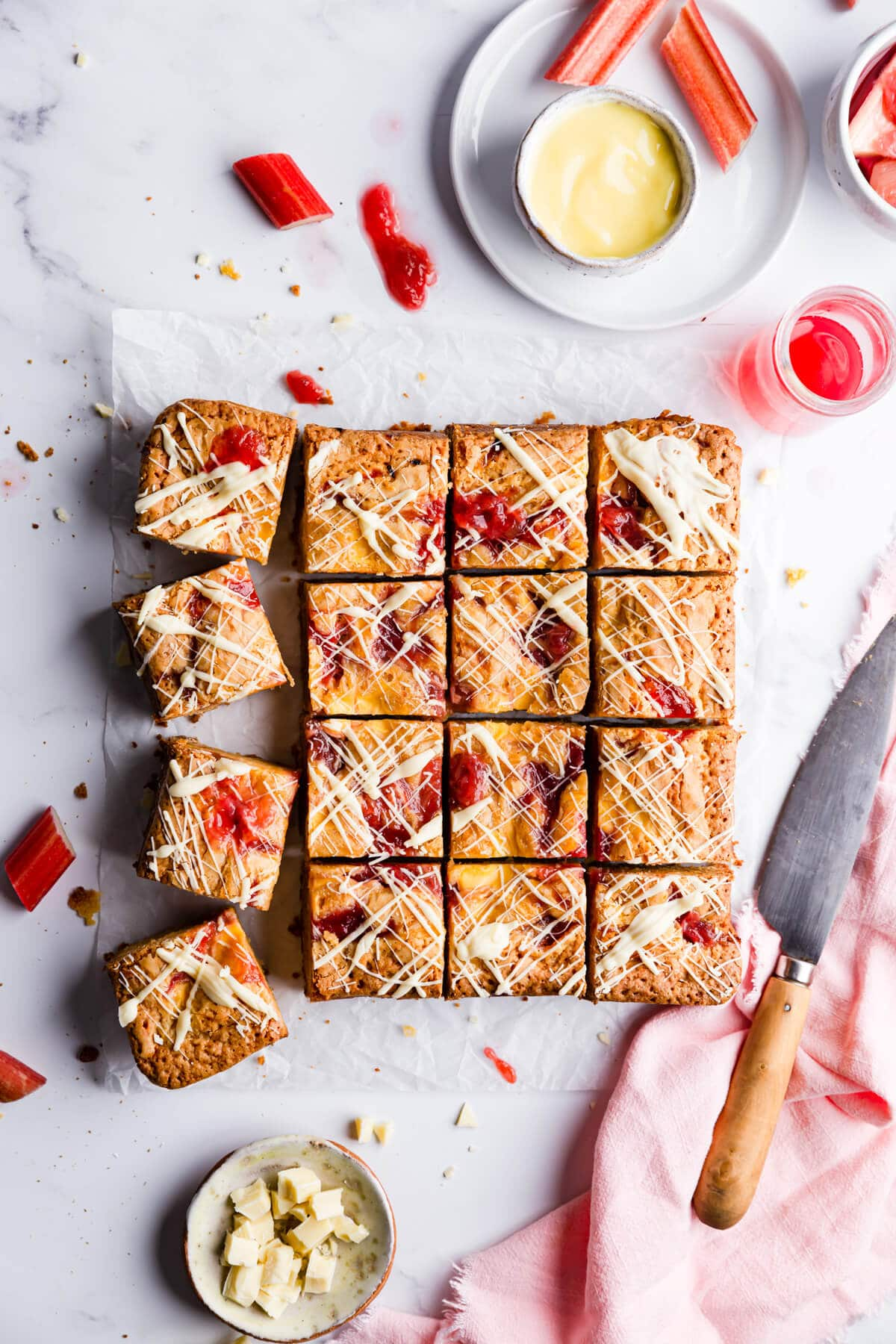 overhead close up at rhubarb and custard blondies cut into 16 squares