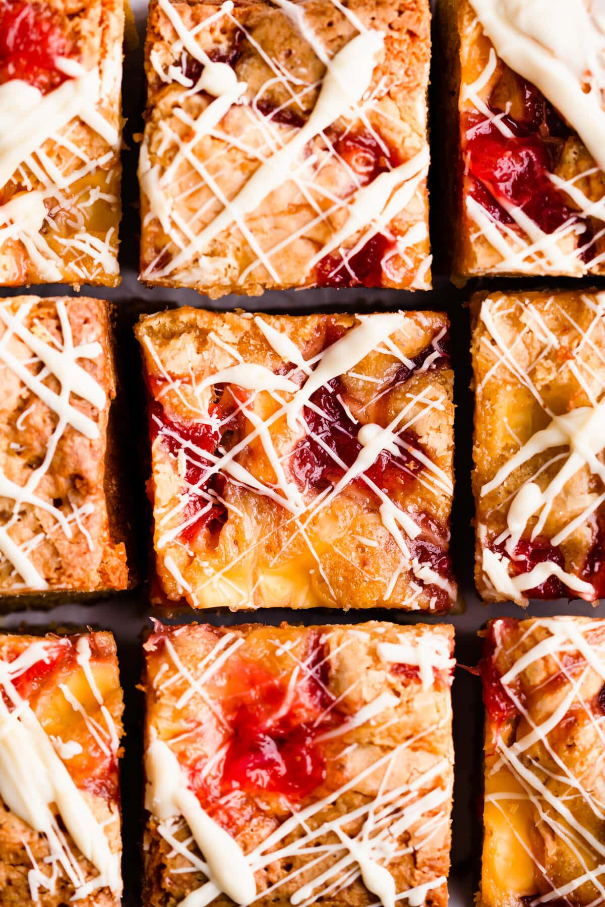 top view super close up at square slices of rhubarb and custard blondies