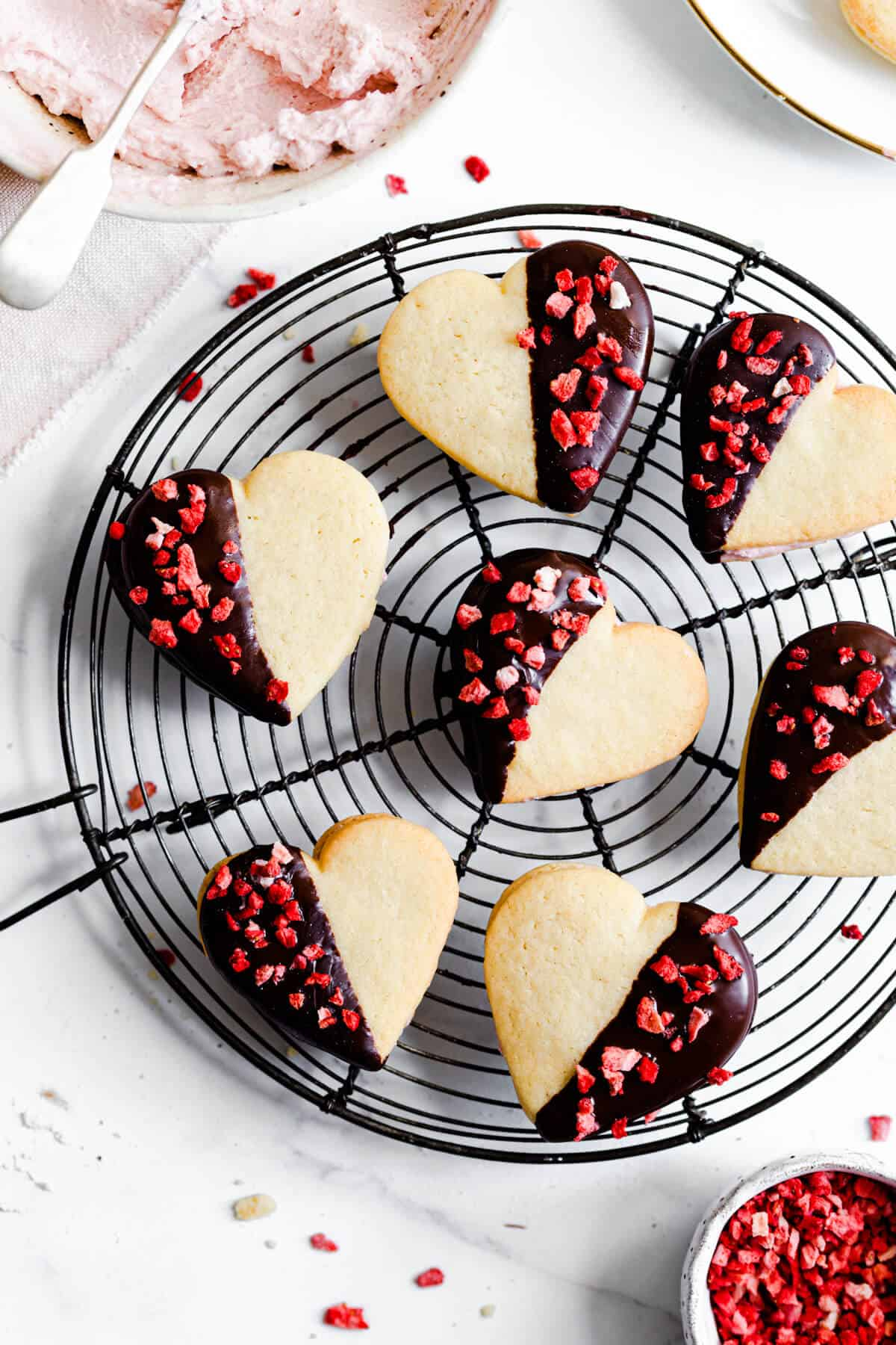 top view close up of heart sandwich cookies on a wire rack