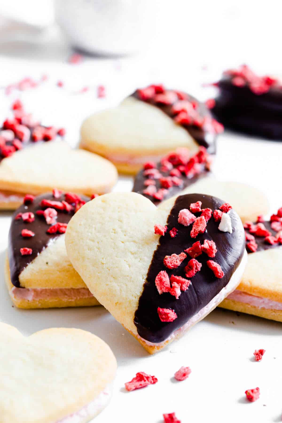 side close up of a sugar cookie topped with freeze dried strawberries