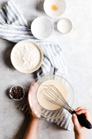 overhead shot of a person mixing pancake batter