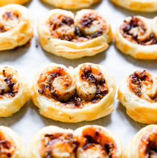side close up of savoury palmiers on white surface